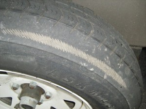 This tire has been damaged by under inflation. Keep an eye on tire tread wear patterns to prevent irreversible damage to your car tires.